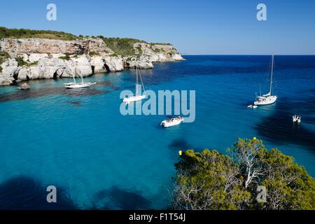Yachts anchored in cove, Cala Macarella, near Cala Galdana, South West Coast, Menorca, Balearic Islands, Spain, - Stock Photo