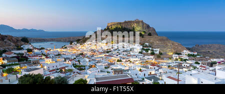 White rooftops of Lindos with the Acropolis of Lindos, Rhodes, Dodecanese, Greek Islands, Greece, Europe - Stock Photo