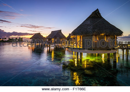French Polynesia : Tikehau Pearl Beach water bungalows at sunset - Stock Photo