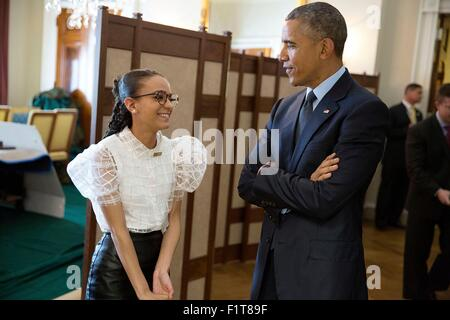 U.S. President Barack Obama talks with National Student Poet Madeline LaCesne in the Old Family Dining Room before - Stock Photo