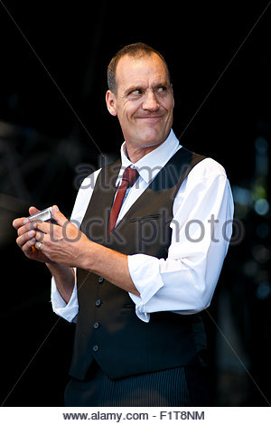 Mountain Men : harmonicist and singer Barefoot Iano performing live - Stock Photo