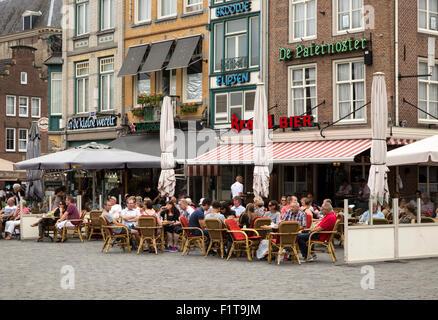People sitting outside cafes in summer s-Hertogenbosch, Den Bosch, North Brabant province, Netherlands - Stock Photo