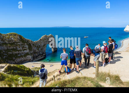 Party of school students on a field trip to Durdle Door, near Lulworth, Jurassic Coast, Dorset, England, UK - Stock Photo