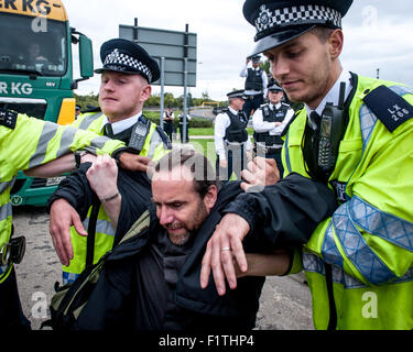 London, UK. 7th September, 2015. Police remove a vicar from the blockade during a protest against the DSEI, one - Stock Photo
