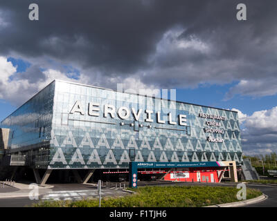 Aeroville Mall under a stormy sky. The glass front of the large mall near Paris' de Gaulle Airport. Parking is underneath. - Stock Photo