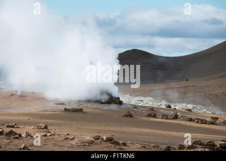 Iceland, Northeast Iceland, Namaskard. Namafjall (aka Hverir) geothermal fields. Active steaming fumaroles. - Stock Photo