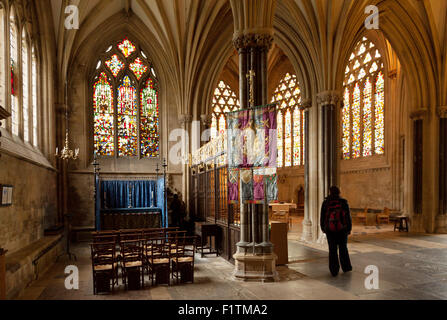 people in the interior of the medieval 12th century Wells Cathedral, Wells, Somerset England UK - Stock Photo