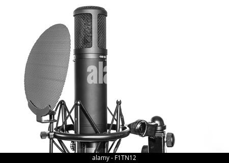Studio microphone with pop filter on white background - Stock Photo