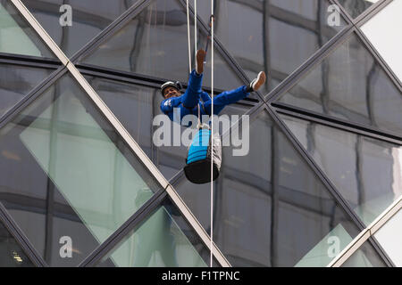 London, UK. September 7th 2015. PICTURED: Jimmy Demetriou descends from the heights of the Gerkhin where he is the - Stock Photo