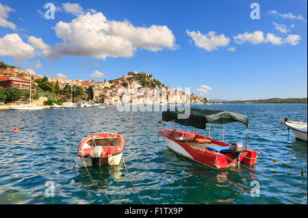 Sibenik on the hill and boats in front. - Stock Photo