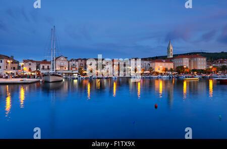 Supetar town on island Brac at evening. - Stock Photo