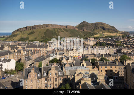Edinburgh - Arthurs Seat and Salisbury Crags, houses, buildings, flats apartments in the Old Town - Stock Photo
