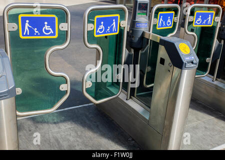 Controlled ticket operated gates for wheelchair and prams and buggies, at the Glasgow Central Railway Station, Scotland, - Stock Photo