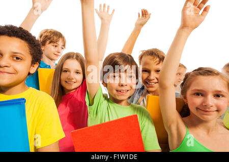 We know the answer, boy in group of kids - Stock Photo