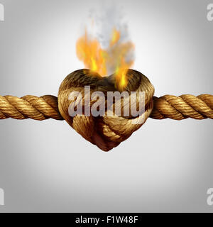 Divorce and separation concept as a rope with a burning knot shaped as a love heart as a relationship problem symbol - Stock Photo