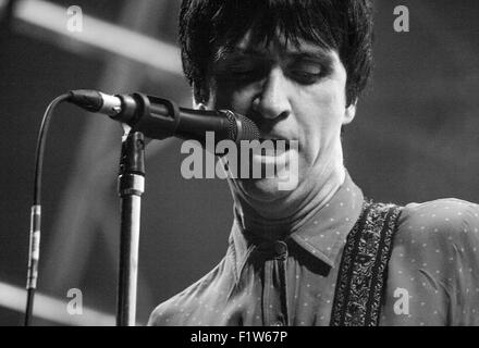 Close up of Johnny Marr singing at Victorious Festival 2015 in black and white. - Stock Photo