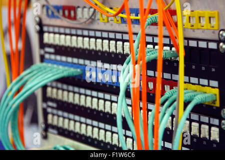 Network switching hardware with cables connected - Stock Photo
