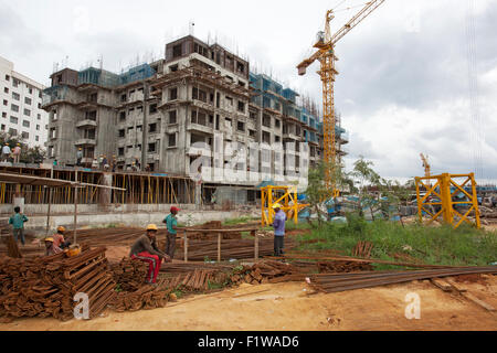 Unidentified workers are employed in construction overhead metro in Bangalore City - Stock Photo