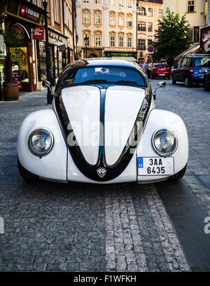 Customised old white Volkswagen Beetle parked on a Prague street, Czech Republic. - Stock Photo