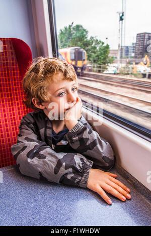 Six year old boy on a Southwest Train , Hampshire, England, United Kingdom - Stock Photo