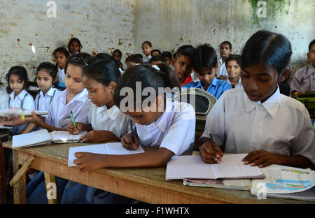 Allahabad, India. 08th Sep, 2015. School children writing inside the classroom at a government-run school during - Stock Photo