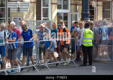 Bighton & Hove football fans travelling from Brighton Rail Station to Falmer Station in transit to the weekend football - Stock Photo