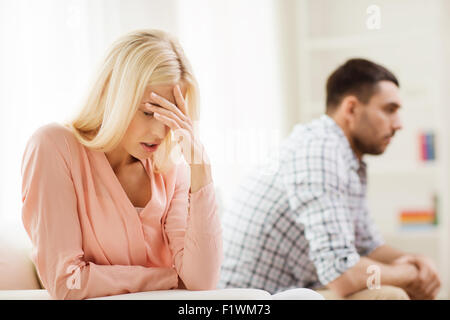 unhappy couple having argument at home - Stock Photo