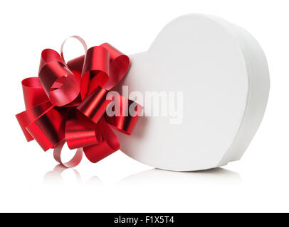 heart shaped gift box with red bow. - Stock Photo