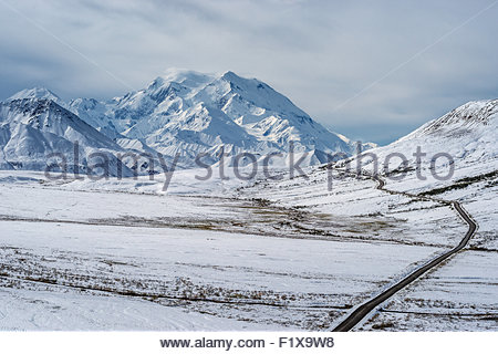 Denali (also known as Mount McKinley) and the park road from a viewpoint near Eielson visitors center - Alaska - Stock Photo