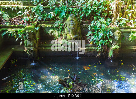Temple Fountain in Monkey forest, Ubud, Bali, Indonesia - Stock Photo