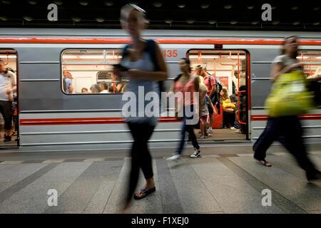 Passengers getting of an underground tube train in Prague, Czech Republic, Eastern Europe - Stock Photo