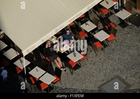 Aerial view of people enjoying the sun at the outdoor White Horse restaurant in Prague, Czech Republic, Europe - Stock Photo
