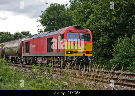 DB Schenker 60092 train on railway line next to the Whisby Nature Park, Near Lincoln, Lincolnshire, UK - Stock Photo