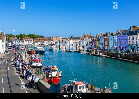 Fishing boats moored at Custom House Quay in Weymouth, Jurassic Coast, Dorset, England, UK - Stock Photo