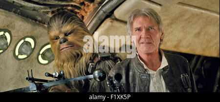 STAR WARS: THE FORCE AWAKENS 2015 Walt Disney Pictures film with Harrison Ford as Hans Solo and Peter Mayhew as - Stock Photo