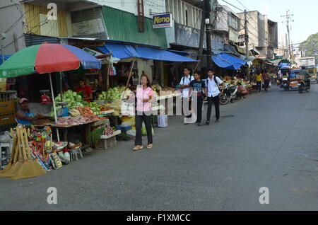 The market place inTugeogharo the northernmost state of thePhilippines. Streets wthstalls selling freshvegetables - Stock Photo