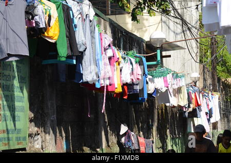 A line full of washing out to dry in the sun. This is the regular sight that greets visitors toM.DelaCruz,a backstreet - Stock Photo