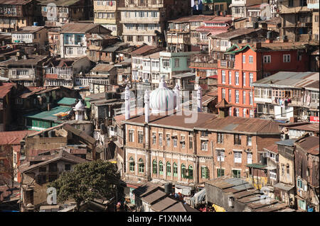 Shimla, Himachal Pradesh, India. View of the jumble of buildings cascading down the hillside which form the centre - Stock Photo