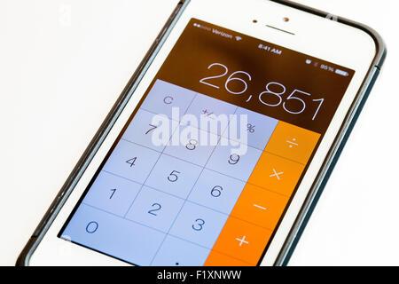 Calculator on iPhone screen - USA - Stock Photo