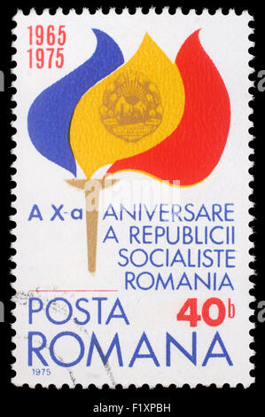 Stamp from Romania shows Torch with Flame in Flag Colors and Coat of Arms, circa 1975 - Stock Photo