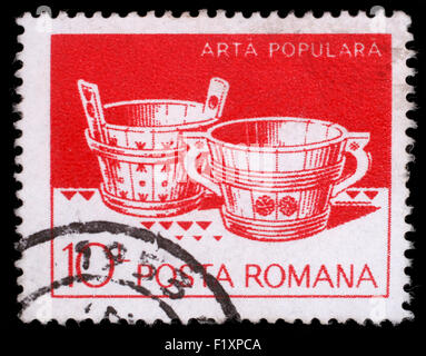Stamp printed in Romania shows Wooden tubs from Hunedoara and Suceava, circa 1982 - Stock Photo