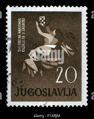 Stamp printed in Yugoslavia dedicated to 100 anniversary of the Croatian National Theater in Zagreb, circa 1960. - Stock Photo