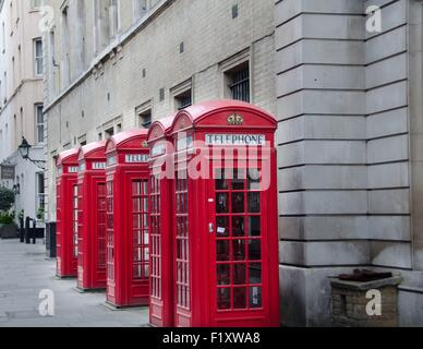 5 classic telephone booths in London, UK - Stock Photo