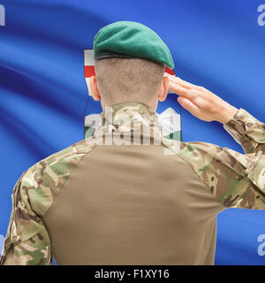 Soldier saluting to Canadial province flag series - Alberta - Stock Photo