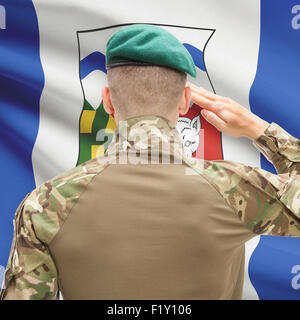 Soldier saluting to Canadial province flag series - Northwest Territories - Stock Photo