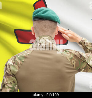 Soldier saluting to Canadial province flag series - Nunavut - Stock Photo