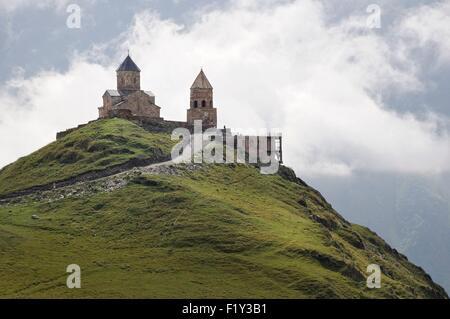 Georgia, Greater Caucasus, Mtskheta-Mtianeti, Stepantsminda, Tsminda Sameba, Gergeti Trinity church - Stock Photo