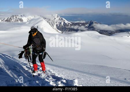 Georgia, Greater Caucasus, Mtskheta-Mtianeti, Mount Kazbek, mountaineers roped together on snow slopes of Mount - Stock Photo