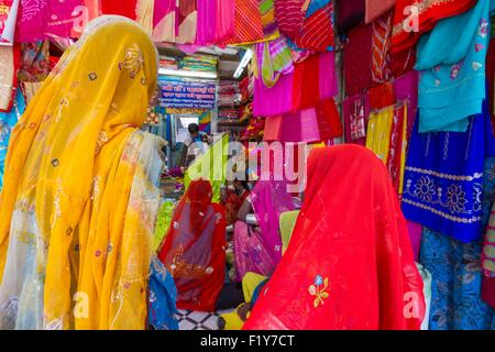 India, Rajasthan State, Jodhpur, women in sari in a clothing store - Stock Photo