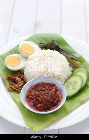 Traditional Malaysian breakfast called Nasi lemak - Stock Photo